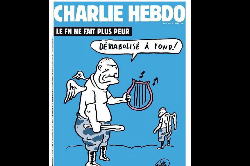 A handout image made available by Charlie Hebdo on Monday shows the cover of the forthcoming edition of the satirical weekly which will be released on Wednesday. It takes a dig at the country's far-right National Front by showing two thuggish skinhea