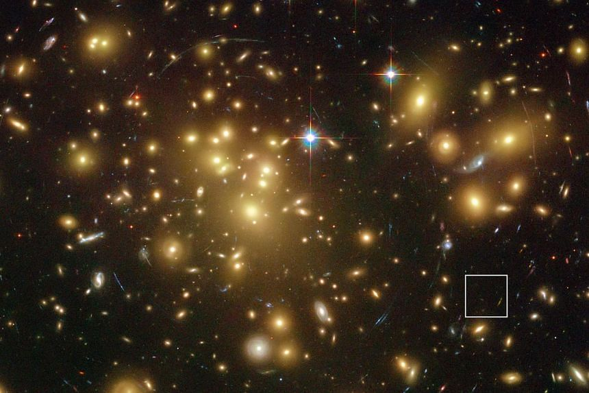 A photo released by the European Southern Observatory (ESO) last week shows the NASA/ESA Hubble Space Telescope image of the rich galaxy cluster Abell 1689. The huge concentration of mass bends light coming from more distant objects and can increase