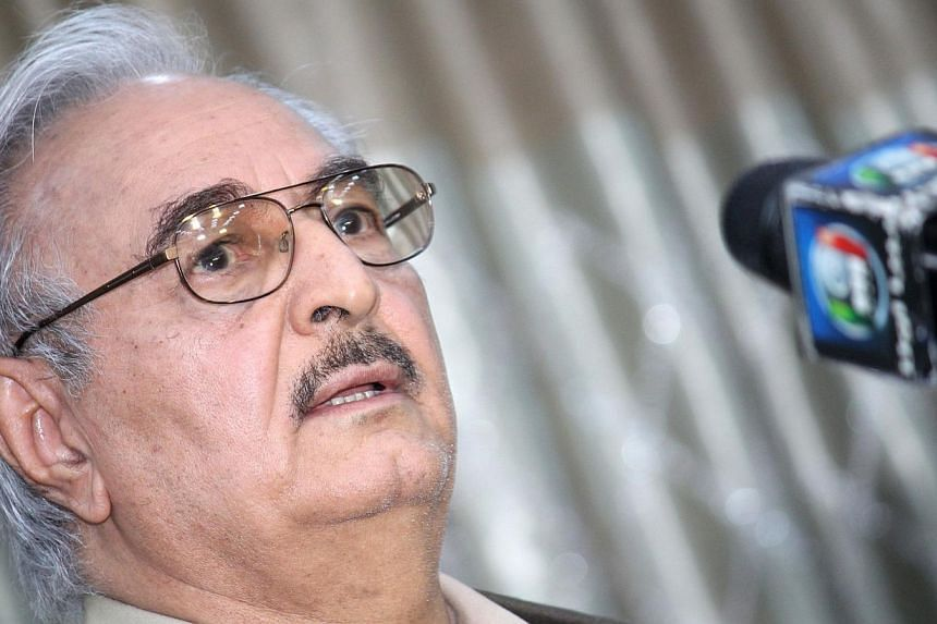 A file picture taken on May 17 last year shows then retired Libyan Army general Khalifa Haftar speaking during a press conference in the town of Abyar, 70 km southwest of Benghazi. -- PHOTO: AFP