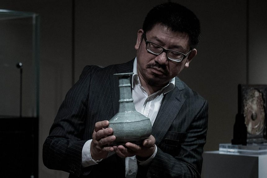 A Chinese Guan Vase of the Southern Song Dynasty is shown to the media in Hong Kong on Monday. The rare vase is expected to fetch more than 60 million HKD at Sotheby's Hong Kong Chinese Works of Art Spring Sales 2015 which will take place on