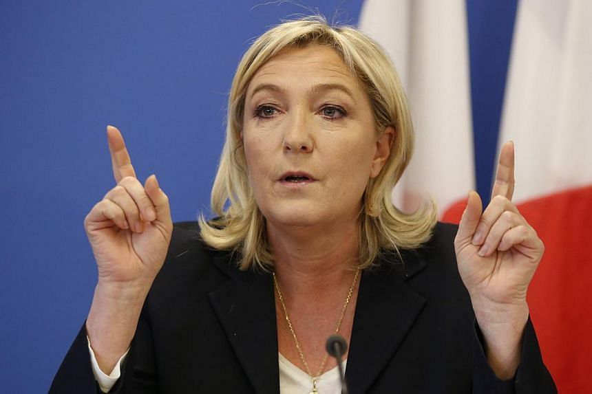 France's National Front political party head Marine Le Pen gestures as she speaks during a news conference at the party headquarters in Nanterre near Paris on Feb 6, 2015.The far-right leader on Tuesday, March 3, 2015, accepted an offer to sit