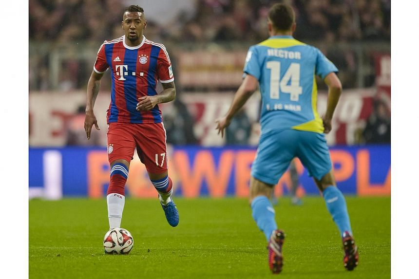 Bayern Munich's defender Jerome Boateng (left) and Cologne's defender Jonas Hector vie for the ball during their German first division Bundesliga football match in Munich on Feb 27, 2015.Boateng revealed he turned down an offer to join Barcelon