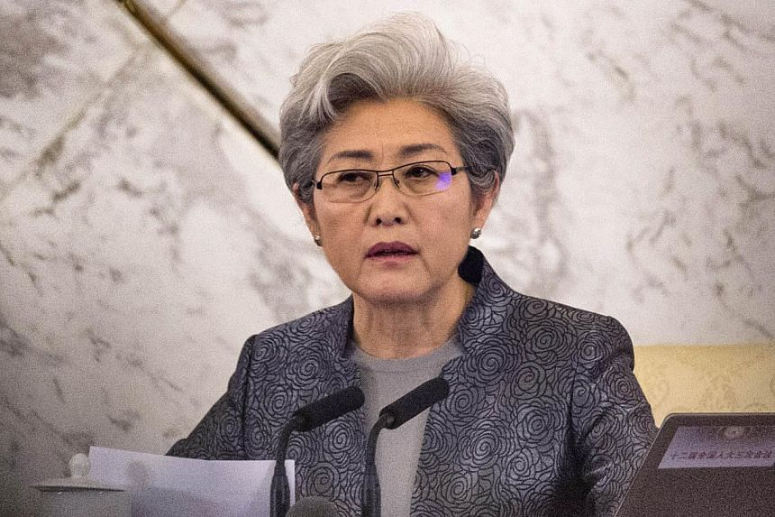 National People's Congress spokesman Fu Ying speaks at a news conference at the Great Hall of the People in Beijing on March 4, 2015.Ms Fu said China's proposed anti-terrorism law will not affect the legitimate interests of technology firms, af