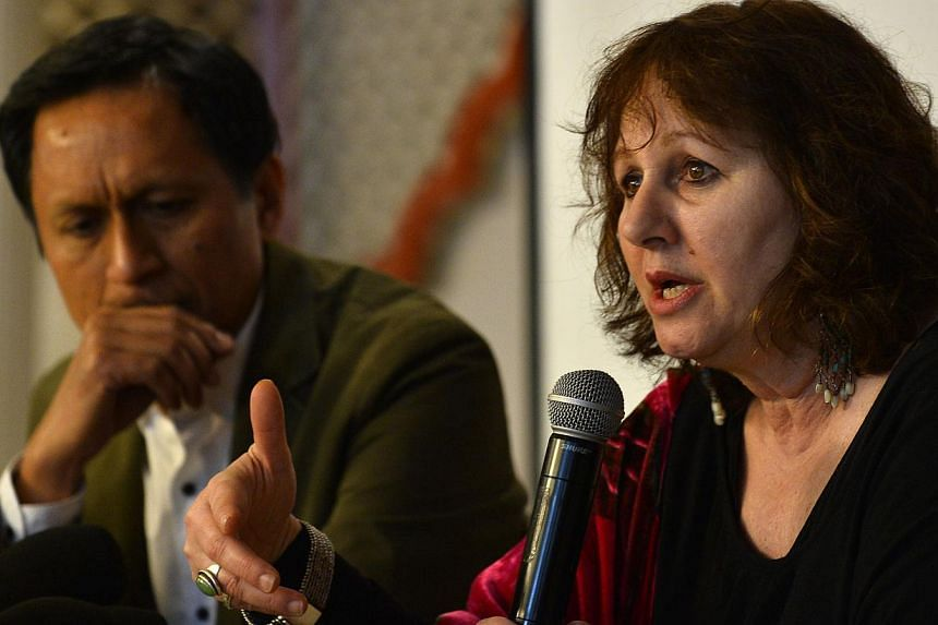 Leslee Udwin (right), director of the documentary India's Daughter, gestures during a press conference alongside her co-producer Indian TV journalist Dibang (left) in New Delhi on March 3, 2015. -- PHOTO: AFP