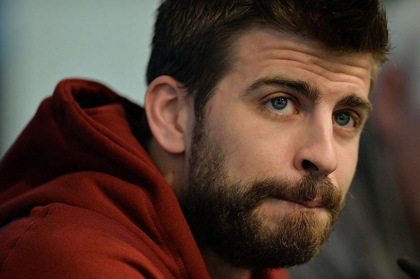 A Spanish judge hit Barcelona star Gerard Pique (above) with a heavy fine after the 2010 World Cup winner lost his temper and insulted two traffic policemen. -- PHOTO: EPA