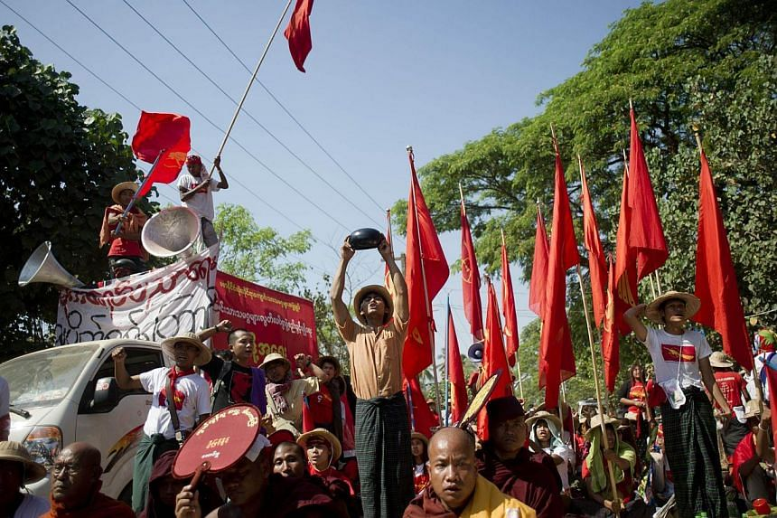 Myanmar students shout slogans during a protest march in Letpadan town, some 130km north of Myanmar's main city Yangon on March 4, 2015. -- PHOTO: AFP