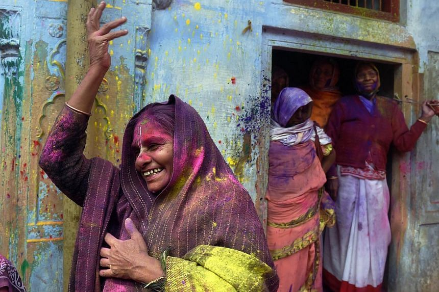 An Indian widow dances as she celebrates Holi or 'festival of colors' in Vrindavan on March 3, 2015. -- PHOTO: AFP