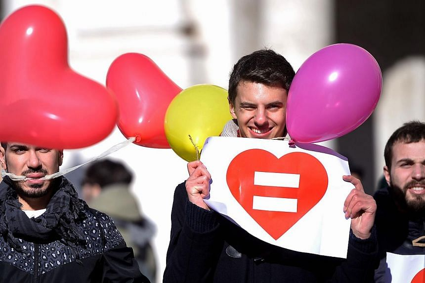 Gay rights supporters stage a protest at Rome's capitol hill square on Jan 28, 2015. Slovenia joined a growing number of European countries that allow same-sex marriages late on Tuesday, almost three years after a similar law was rejected in a nation