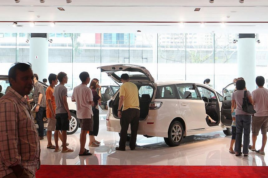 Assuming a vehicle has an open market value of $30,000, it should attract $2,100 in GST. But after the 20 per cent excise duty is applied, the car costs $36,000, and its GST becomes $2,520 - $420 more.-- ST PHOTO: ONG WEE JIN, ST FILE