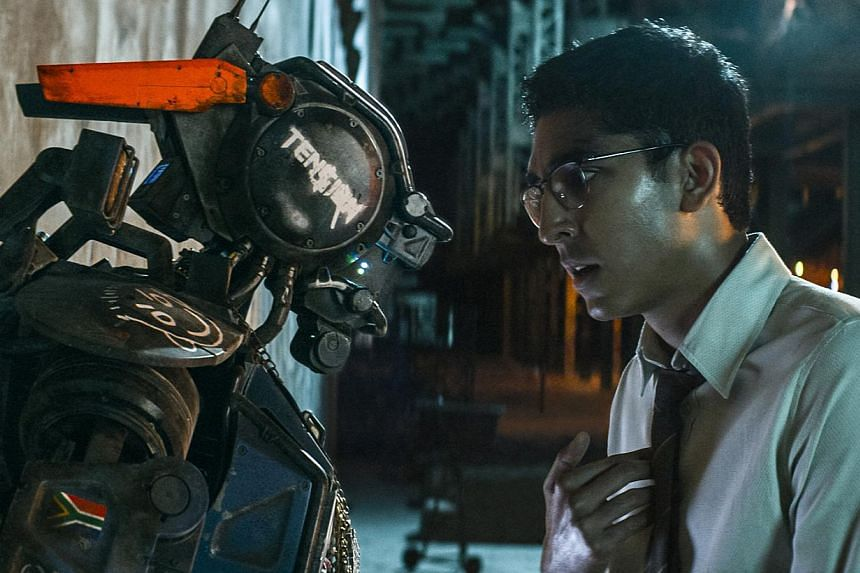 Dev Patel stars as Deon, the tech guru who engineers Chappie (both left), a robot freshly programmed with sentient intelligence, while Sigourney Weaver (above) plays Patel's boss.