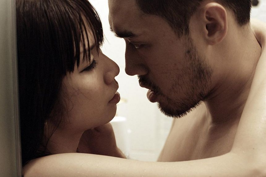 Angeline Yap and William Lawandi in a steamy scene from Lang Tong. -- PHOTO: MM2 ENTERTAINMENT