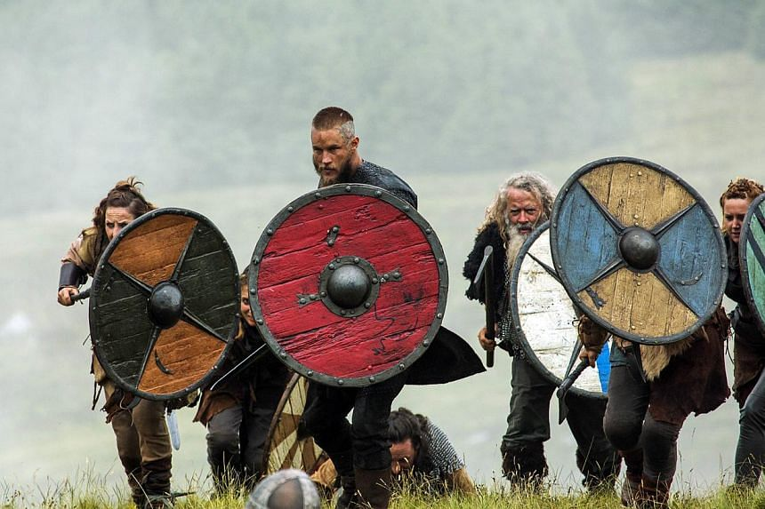 Ninth-century Viking chief Ragnar Lothbrok (Travis Fimmel, above with red shield). -- PHOTO: HISTORY CHANNEL