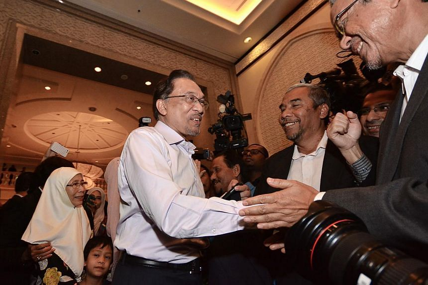 Malaysian opposition leader Anwar Ibrahim (centre) and his wife Wan Azizah (back left) arrive at the Federal Court ahead of a ruling on his appeal of a sodomy conviction in Putrajaya, outside Kuala Lumpur on Feb 10, 2015. An appeal for Anwar to atten