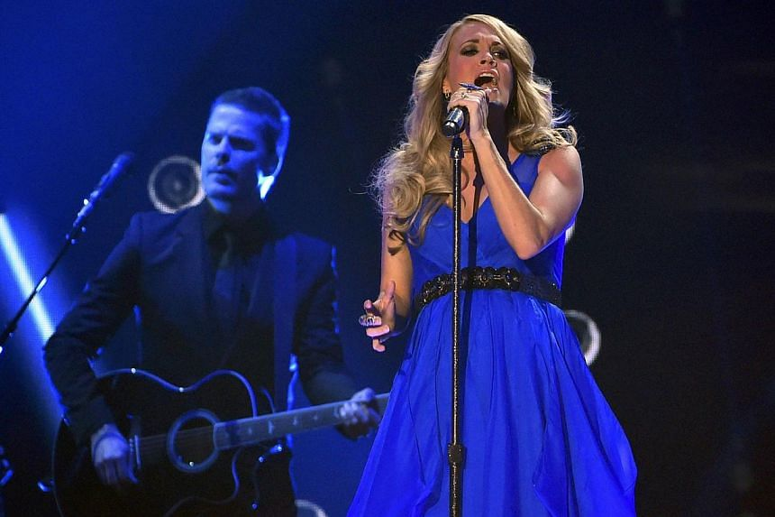 Carrie Underwood performing at the American Country Countdown Awards in Nashville, Tennessee on Dec 15, 2014. -- PHOTO: REUTERS