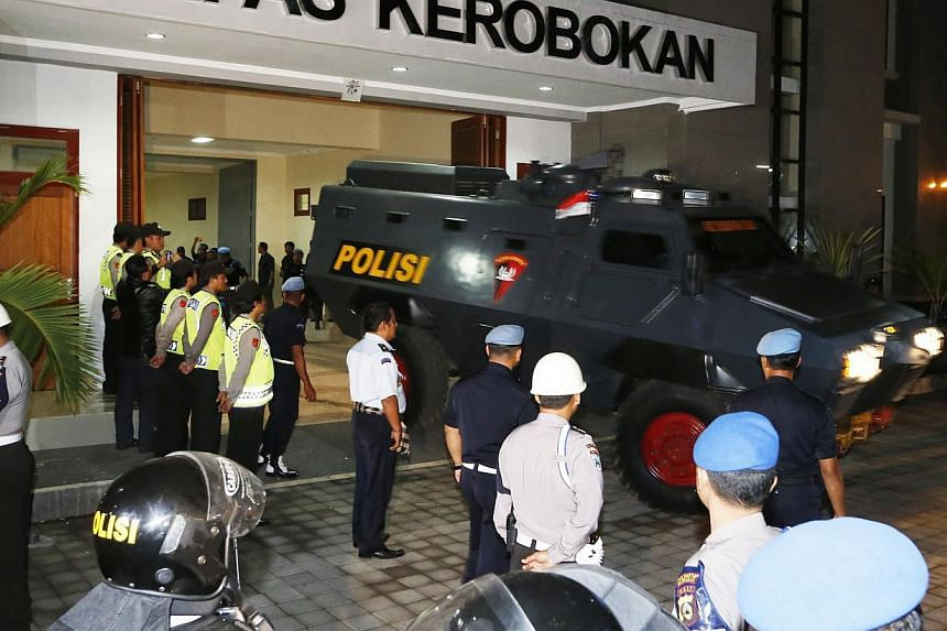 An amoured vehicle, believed to be carrying Australian death row prisoners Myuran Sukumaran and Andrew Chan, leaving Kerobokan Prison for the airport in Denpasar, Bali, on March 4, 2015. -- PHOTO: REUTERS