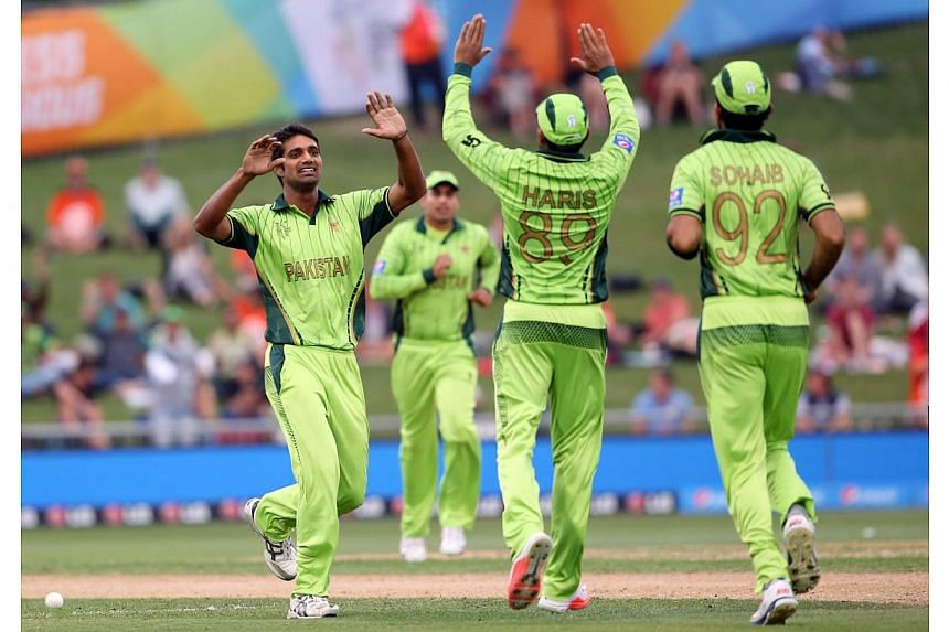 Pakistan's Rahat Ali (left) celebrates the wicket of UAE's Amjad Ali during the Pool B Cricket World Cup match between the United Arab Emirates (UAE) and Pakistan at McLean Park in Napier on March 4, 2015. -- PHOTO: AFP