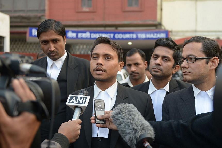 Indian lawyer Alok Dwivedi (centre), who represents Uber taxi driver Shiv Kumar Yadav, who has been accused of the rape of a female passenger, speaks to media outside the Tis Hazari District court in New Delhi on Jan 15, 2015.An Indian court on