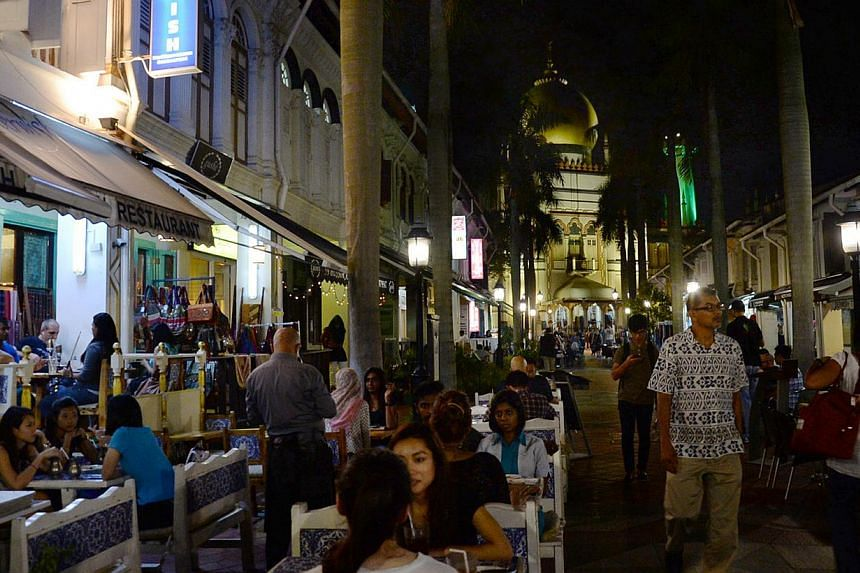 Arab Street in Kampong Glam is a hive of activity, attracting both locals and tourists alike.-- PHOTO: BERITA HARIAN FILE