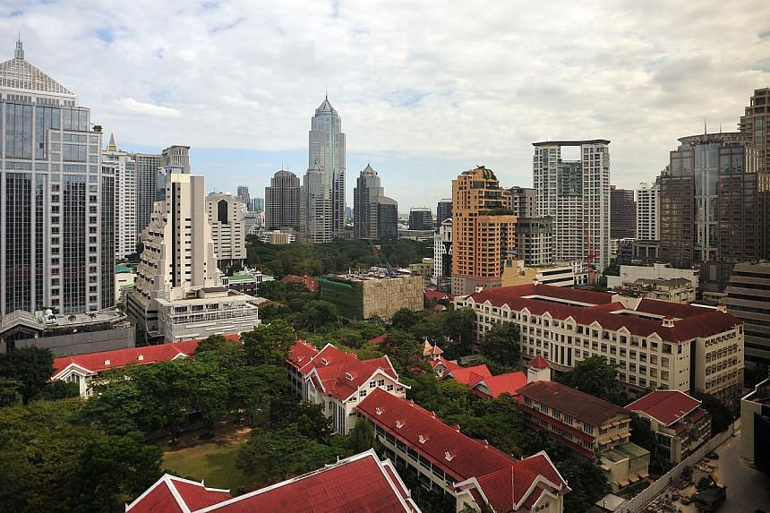 Skyline of Bangkok, Thailand. The Land of Smiles has lived up to its moniker and received the lowest score on the misery index, and therefore the top spot on Bloomberg's happiest list. -- PHOTO: ST FILE