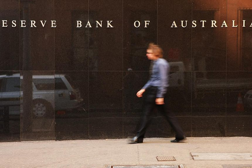 The Reserve Bank of Australia's headquarters in Sydney. The Australian Securities & Investments Commission will look into a curious spike in the local dollar moments before the central bank announced its rate decision the previous day. -- PHOTO: