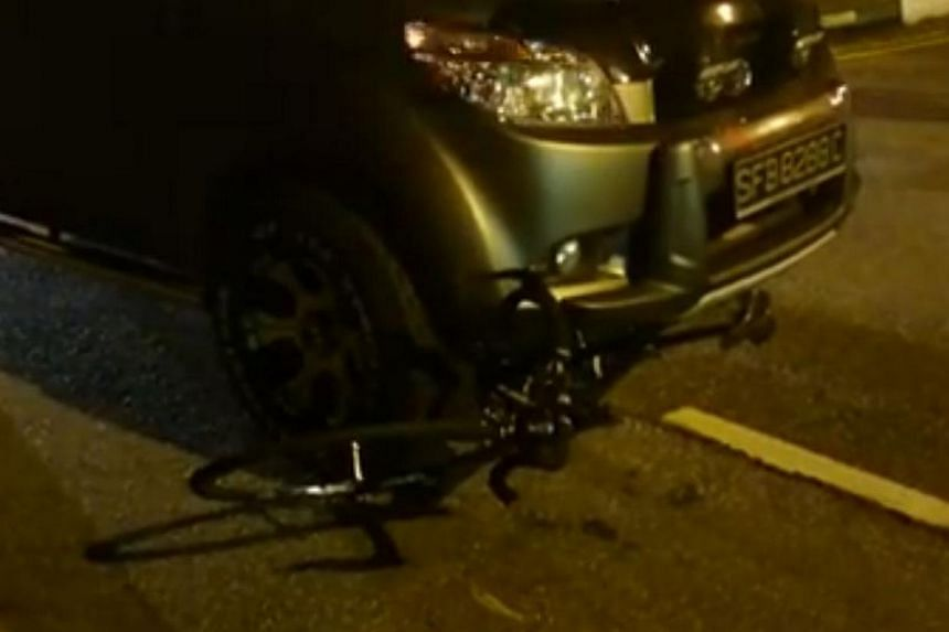 National cyclist Vincent Ang's bicycle pinned under the car after a collision on Wednesday morning. -- PHOTO: SCREENGRAB FROM VINCENT ANG'S FACEBOOK