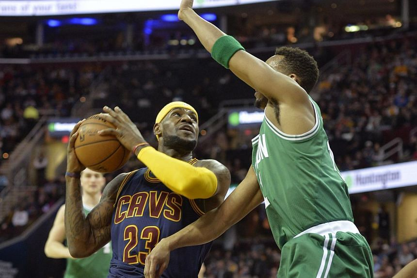 Cleveland Cavaliers forward LeBron James (#23) drives against Boston Celtics guard Evan Turner (#11) in the first quarter at the Quicken Loans Arena in Cleveland, Ohio, on March 3, 2015. -- PHOTO: DAVID RICHARD - USA TODAY SPORTS