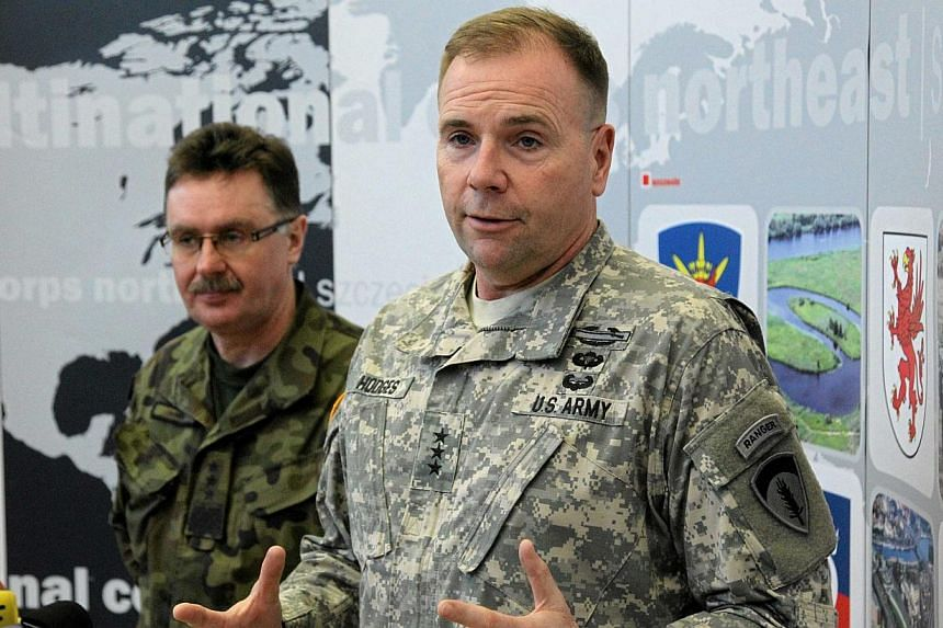 The US military estimates around 12,000 Russian soldiers are supporting pro-Moscow separatists in eastern Ukraine, US Army Europe commander Ben Hodges (above right) said on Tuesday. -- PHOTO: REUTERS