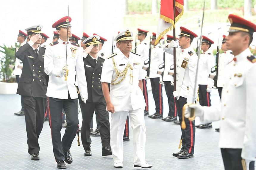 First Admiral (Fadm) Dato Seri Pahlawan Abdul Aziz Haji Mohammad Tamit inspecting a guard of honour at the Ministry of Defence. -- PHOTO: MINDEF