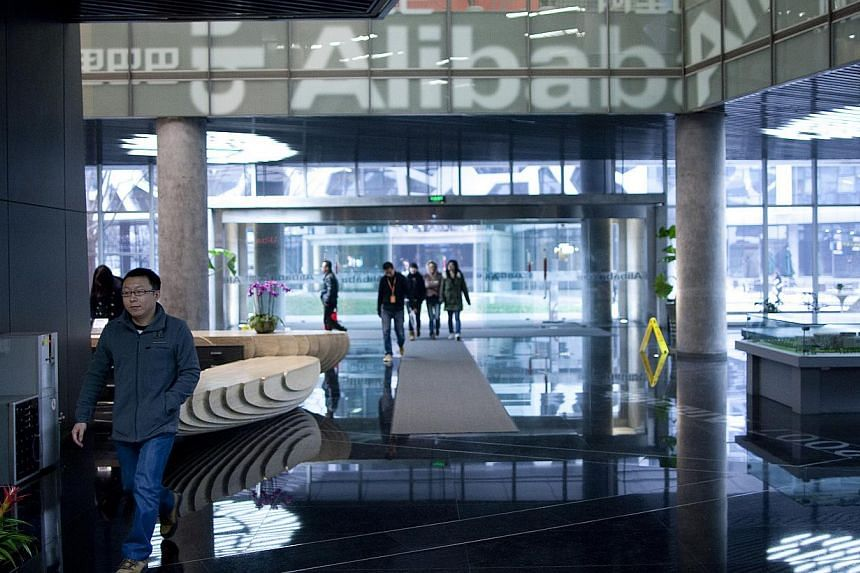 People walk through Alibaba's headquarters in Hangzhou, Zhejiang Province, China. The Internet company is launching a cloud computing hub in Silicon Valley on Wednesday, the e-commerce giant's first outside of China, underscoring its global ambitions