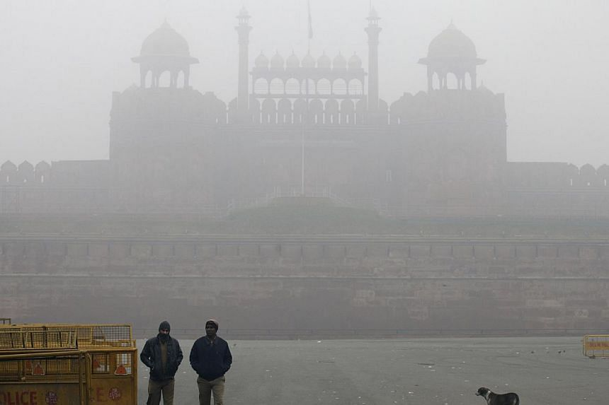 The Red Fort covered by haze mainly caused by air pollution in Delhi, India, on Jan 20, 2014. -- PHOTO: BLOOMBERG
