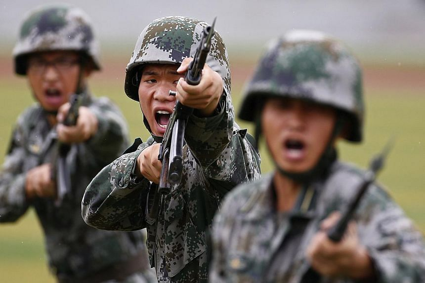 China's defence budget this year will rise about 10 per cent compared with 2014, a spokesman for the country's parliament said on Wednesday. -- PHOTO: REUTERS