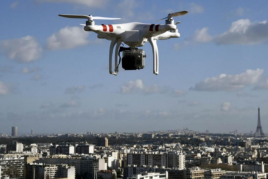 Paris police on Wednesday said the public had reported around a dozen drone sightings over sensitive areas of the French capital - the latest in a baffling series of overflights. -- PHOTO: AFP