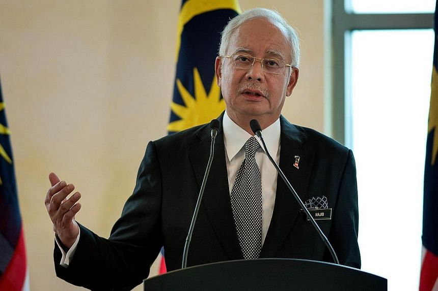 Malaysia's PM Najib Razak said that he has instructed the country's Auditor General to independently verify the accounts of state development company 1Malaysia Development Bhd (1MDB). -- PHOTO: AFP