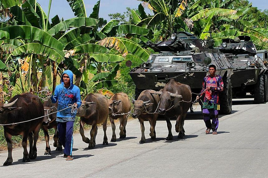 About 45,000 people have fled their homes in the impoverished southern Philippines as the military hunts Islamic militants, including a top terror suspect wanted by the United States, authorities said on Wednesday. -- PHOTO: AFP