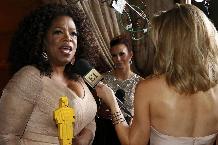 Oprah Winfrey holds a lego Oscar statue while being interviewed at the Governor's Ball following the 87th Academy Awards in Hollywood, California on Feb 22, 2015. Winfrey announced on Tuesday that she will be shutting down Harpo Studios in Chicago af
