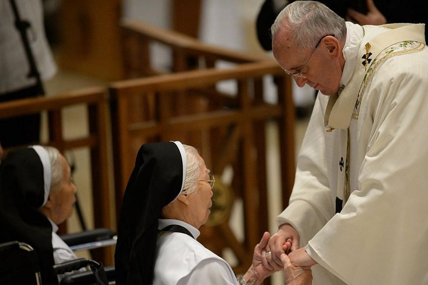 "Pope Francis greeting elderly nuns while celebrating mass with bishops and priests at the Manila cathedral on Jan 16, 2015. The Pope has urged his followers to show affection and respect for the elderly, saying they must not be treated as ""alien"