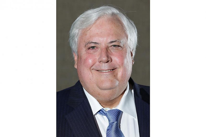 Flamboyant mining billionaire Clive Palmer has apologised after coming under fire for suggesting Australian Prime Minister Tony Abbott commit suicide. -- PHOTO: BLOOMBERG