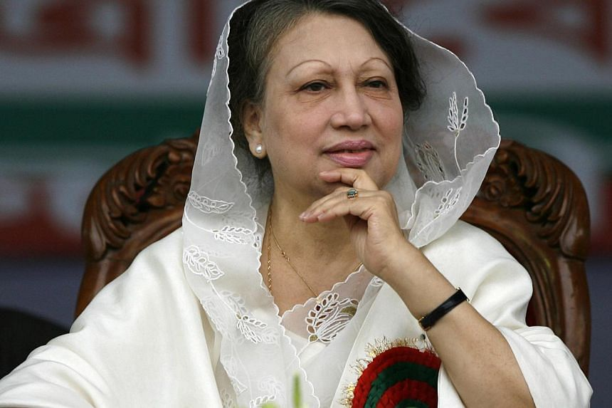 A Bangladeshi court on Wednesday upheld arrest warrants against opposition leader Begum Khaleda Zia (above) and called her a fugitive after she again failed to appear to face graft charges that have stoked political tensions. -- PHOTO: REUTERS