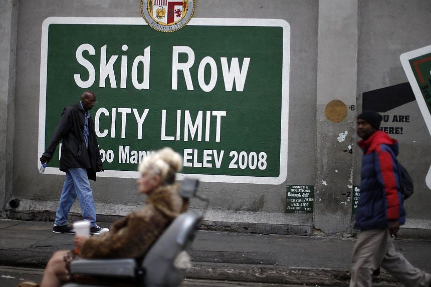 People view a memorial for a man killed by police on skid row in Los Angeles, California on Monday. -- PHOTO: REUTERS
