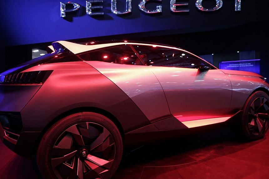 A Peugeot Quartz concept automobile, produced by PSA Peugeot Citroen, stands on display ahead of the 85th Geneva International Motor Show in Switzerland. The show opens to the public on Thursday. -- PHOTO: BLOOMBERG