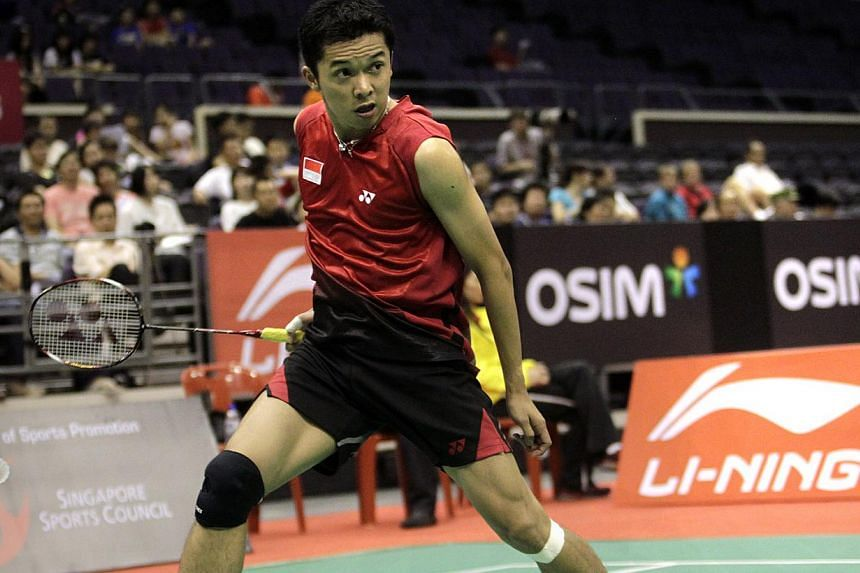 Indonesian badminton player Taufik Hidayat watching a smash from Malaysia's Daren Liew whizz past him during their first-round men's singles match at the Li-Ning Singapore Open on June 15, 2011.  -- PHOTO: KEVIN LIM
