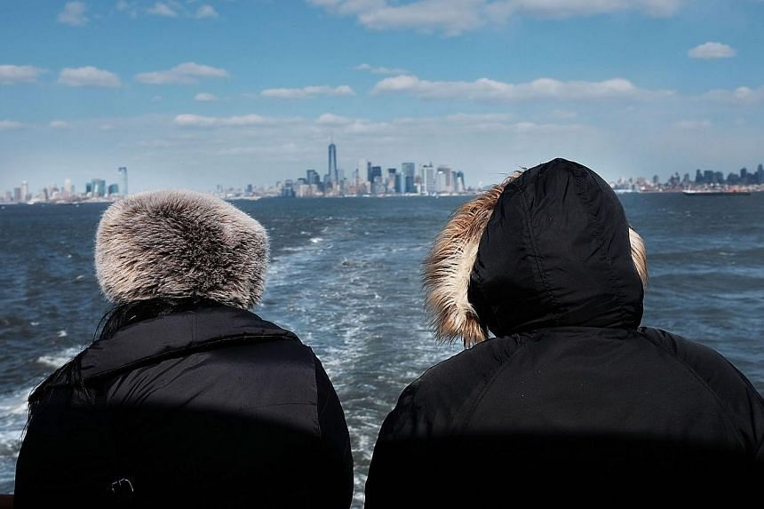 The New York skyline as seen from the Staten Island ferry on Feb 19, 2015.Rent will gobble up nearly 60 per cent of New Yorkers' income in 2015 with the median cost of an apartment to rise to US$2,700 (S$3,680) a month, a real-estate website sa
