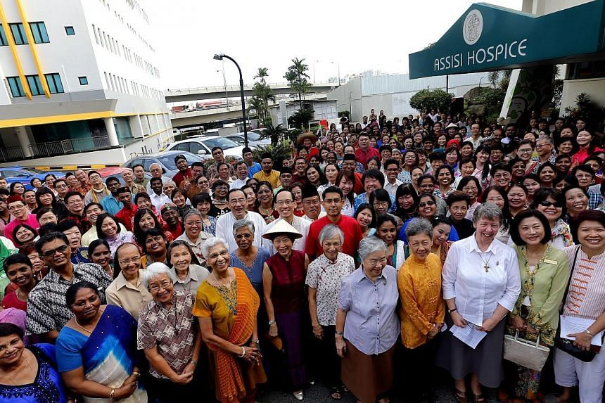 More than 300 people took part in a mass walk event to commemorate Mount Alvernia Hospital's 54th anniversary. The hospital also announced plans to launch a fund-raising event to support the Yusof Ishak Professorship Fund  -- ST PHOTO: