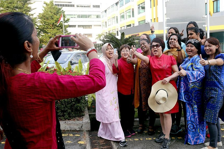Staff from Mount Alvernia Hospital taking photos outside the hospital. -- ST PHOTO: CHEW SENG KIM