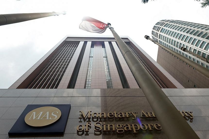 The Monetary Authority of Singapore (MAS) building at Shenton Way on March 13, 2014. The Reserve Bank of India surprised markets on Wednesday with a cut to its key lending rate for the second time this year, joining a worldwide trend of monetary