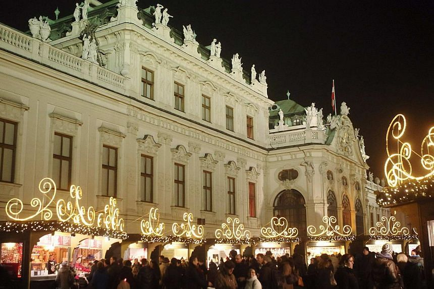 The Belvedere palace is pictured behind an advent market in Vienna on Dec 15, 2014. Vienna, Austria's elegant capital on the Danube river, has again been commended as offering the best quality of life of any city in the world. -- PHOTO: REUTERS