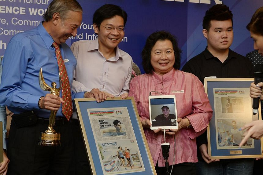 Joseph Schooling's parents Colin (in blue) and May (in pink) posing with Minister for Culture, Community and Youth Lawrence Wong (in white) during The Straits Times (ST) Athlete of the Year ceremony held Raffles Hotel on March 5, 2015. With them