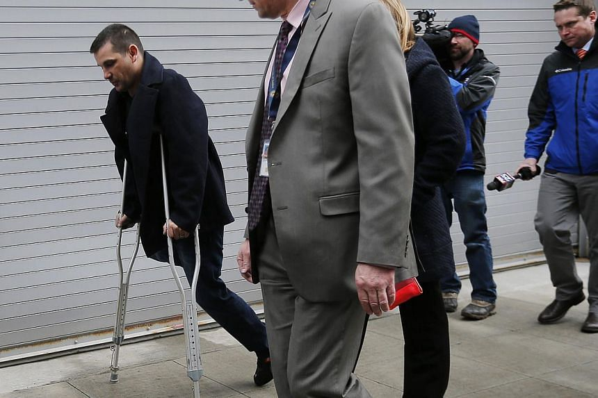 Boston Marathon bombing survivor Marc Fucarile (left) leaves the federal courthouse on the first day of the trial of accused bomber Dzhokhar Tsarnaev in Boston, Massachusetts on Mar, 4, 2015. Survivors of the 2013 bombings choked back tears on Wednes