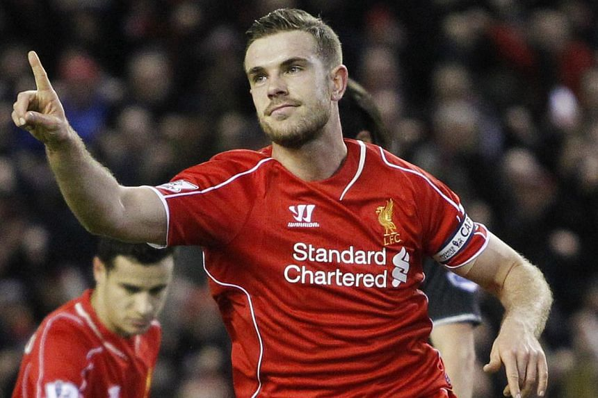 Jordan Henderson celebrates after scoring the first goal for Liverpool during their English Premier League match against Burnley at Anfield on March 4, 2015. Reds manager Brendan Rodgers said Henderson could aspire to reach an even higher l