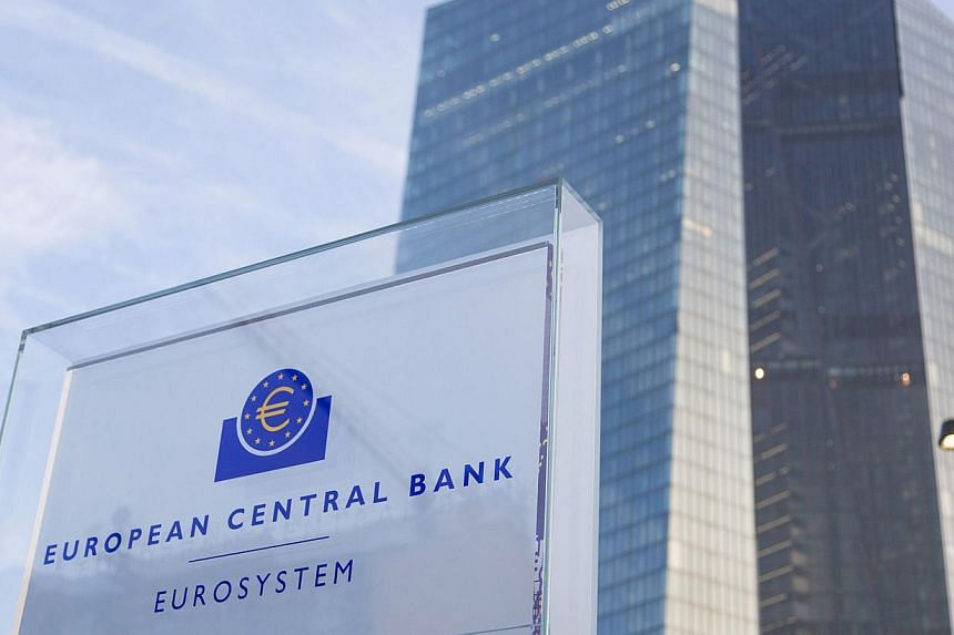 A sign sits outside the new headquarters of the European Central Bank (ECB) in Frankfurt, Germany, on Feb 13, 2015. Keen to keep a low profile over the Greek crisis, the ECB will focus on improved growth prospects when it meets on Thursday and unveil